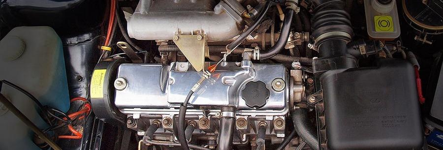 Силовой агрегат ВАЗ 2111 под капотом Лада 110.